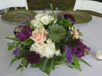 Fun centerpieces of hydrangea, roses, sedum, carnations & stock