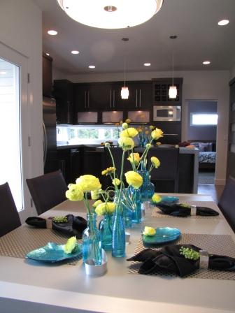 Aqua vases with yellow flowers