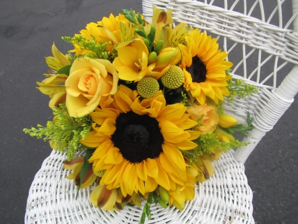 sunflowers, freesia, roses, billy balls, alstromeria and solid aster