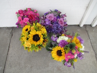 yellow bouquet, pink bouquet, purple bouquet