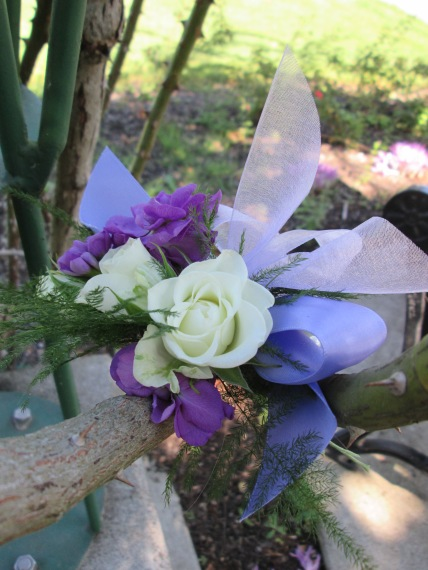 purple and white corsage